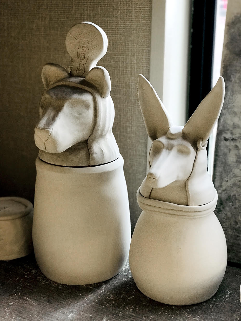 Vases with dogs
